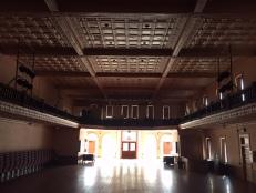 Pocahontas auditorium, empty, pressed tin